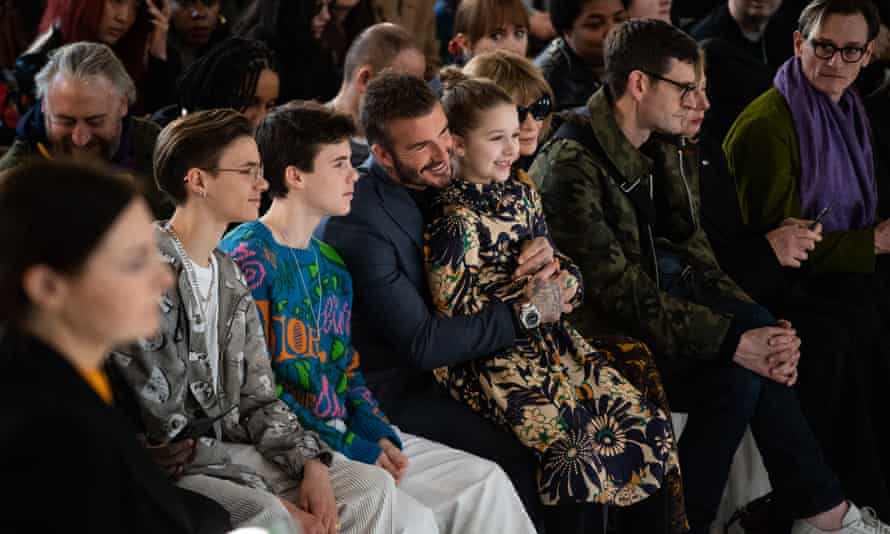 Victoria Beckham's London fashion week show in February this year, watched by Romeo, Cruz, David and Harper Beckham.
