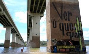Thiago Mundano splashes the mural he painted