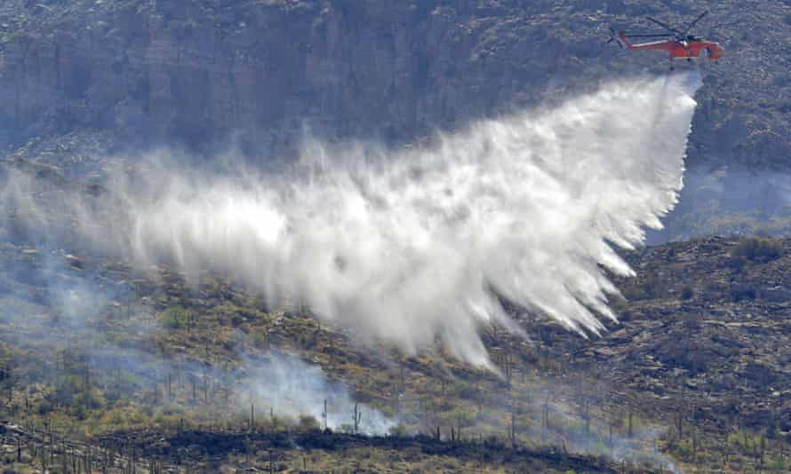 A wildfire air attack crew battles the Bighorn fire along the western side of the Santa Catalina Mountains on 12 June.