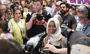 Ilhan Omar speaks to supporters as she arrives at the Minneapolis-St Paul international airport in Minnesota on 18 July 2019.