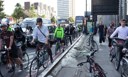 Cyclists commute to work during London tube strike on 9 Jul 2015.