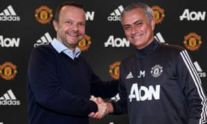 Ed Woodward shakes hands with José Mourinho after the Manchester United manager signed a contract extension in January 2018