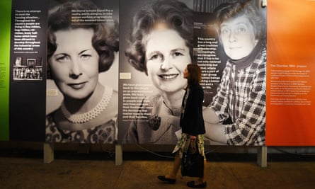 A visitor views photographs in the Women's Place in Parliament exhibition in Westminster Hall, June 2018