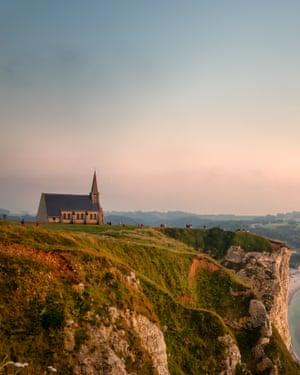 View on the the falaise d'Aval in Etretat, Cote d'Albatre, Normandy, France,at sunset. Also seen the Chapel Notre-Dame de la Garde.