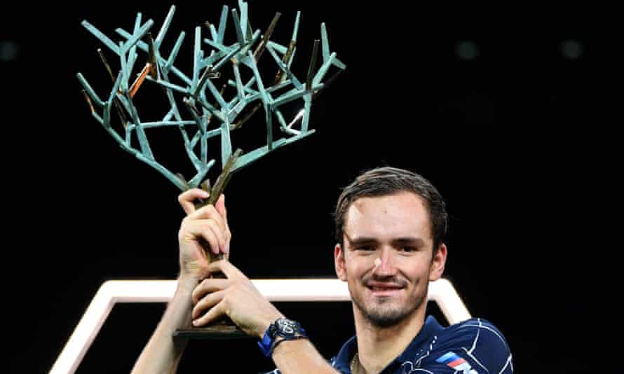 Daniil Medvedev celebrates with the trophy after defeating Alexander Zverev in three sets in the Paris Masters final.