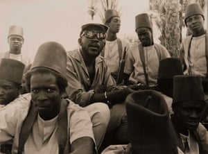 Sembène with guerrilla fighters serving as extras on Emitai, 1971