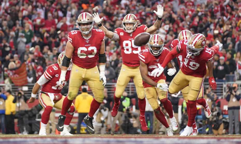 Raheem Mostert celebrates one of his four touchdowns against the Packers