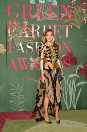Arizona Muse presented the winner of this year's Green Carpet talent competition, Flavia La Rocca, with the Franca Sozzani GCFA award for best emerging designer. She wore a Alexander McQueen dress rented from the luxury fashion platform MyWardrobe.