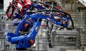 Robots on a production line at AkzoNobel's new paint factory in Ashington, Northumberland