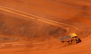 A tipper truck climbing out of a mine
