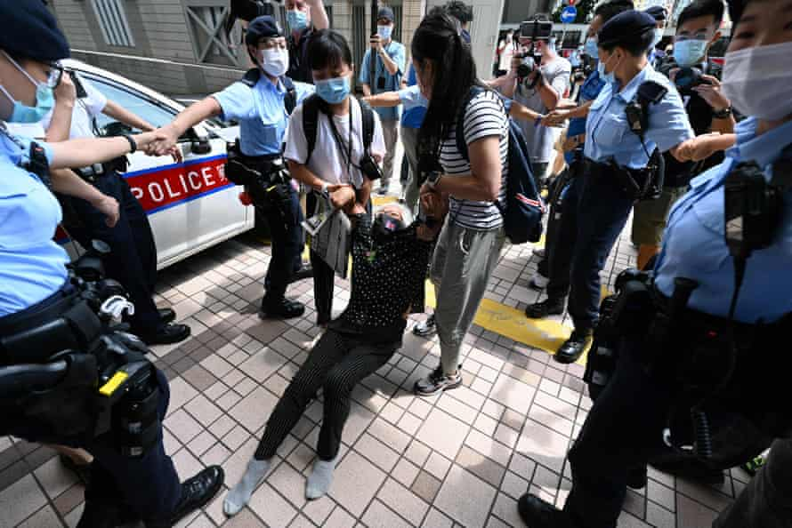 Well known pro-democracy protester Grandma Wong is dragged away by police inside the court grounds in Hong Kong on Saturday.