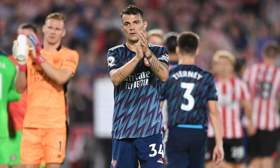 Granit Xhaka applauds the fans after Arsenal's defeat at Brentford