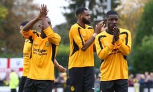 Merstham players thank their fans after the final whistle.