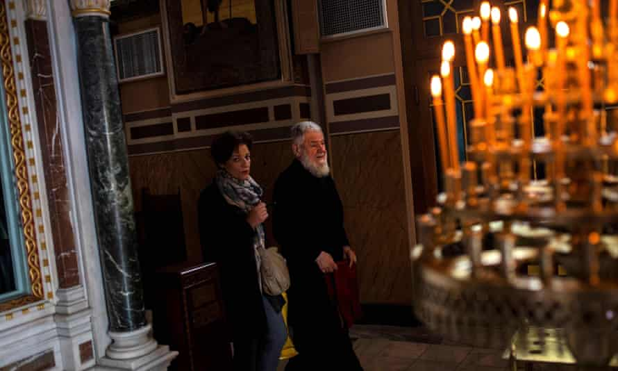 A Greek Orthodox priest (right) with a Greek Orthodox pilgrim inside Athens' Metropolitan church