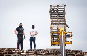 Masked men build a bonfire at Inverary playing fields
