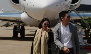 Potential customers walk past a private jet during an aviation show at the Shanghai Hongqiao airport, China.