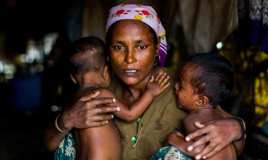 Shamijder, a Rohingya refugee, with her one-year-old twins. An estimated 110,000 Rohingya live in an overcrowded camp on the outskirts of Sittwe, Myanmar.