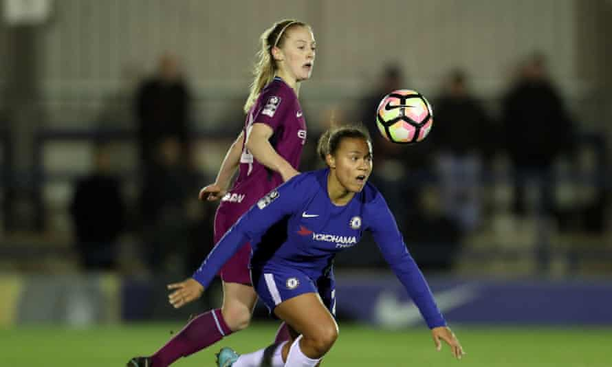 Chelsea's Drew Spence keeps possession under pressure from Keira Walsh of Manchester City.