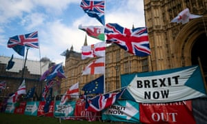 Flags and signs left by protesters outside the Houses of Parliament.