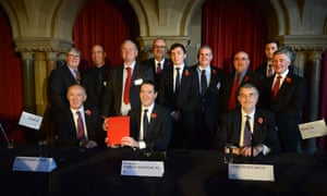 George Osborne and the 12 leaders of councils in Greater Manchester announce its devolution deal in November 2014.