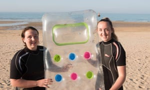 Eilidh Noble (left) and Isla with the lilo they used to save the man and child