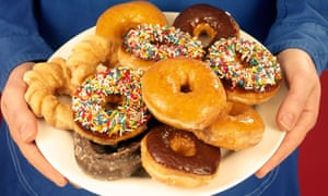 Man holding plate of doughnuts