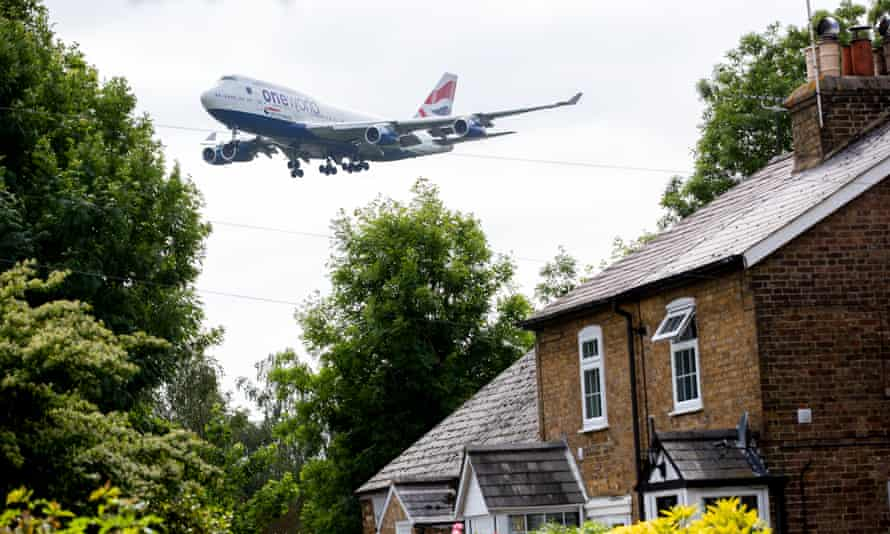 A plane landing at Heathrow Airport in west London, as a third runway at the airport has been given the go-ahead.