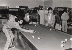 Photograph of men playing pool in an arcade in Melbourne.