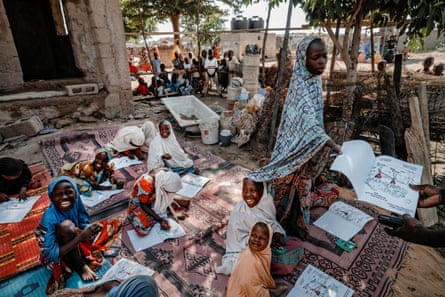 Young girls participate in a risk education lesson in Maiduguri.