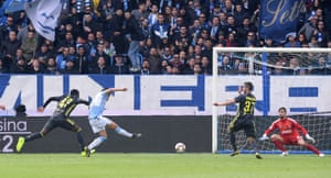 SPAL's Sergio Floccari slots the ball into the net to give the home side the lead.