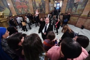 Governor Jared Polis greets school groups at the Colorado statehouse.