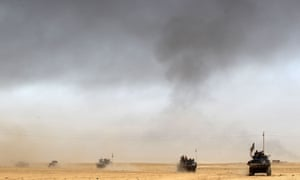 Iraqi tanks advance in the desert as the battle for Mosul begins