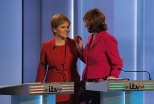 Nicola Sturgeon, Scotland's first minister and leader of the Scottish National party, speaks to Leanne Wood, leader of Plaid Cymru, during the ITV leaders' debate in Manchester on Thursday evening