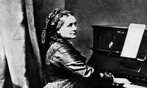 The German composer Clara Schumann plays an upright piano