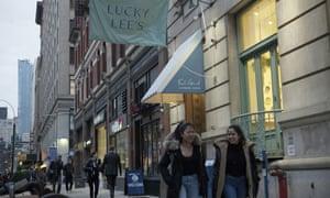 Pedestrians walk past the Lucky Lee's restaurant in Greenwich Village, New York City.