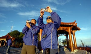 Chinese tourists taking pictures of the sunrise at Taiwan's most famous tourist spot Alishan. Despite political tensions, Taiwan has become a popular tourist destination for Chinese since it conditionally lifted a ban on sightseeing by mainland Chinese in 2002. AFP PHOTO/Sam YEH (Photo credit should read SAM YEH/AFP/Getty Images)