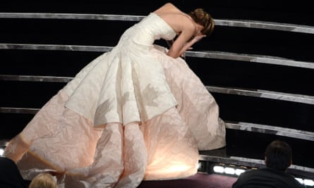 Jennifer Lawrence takes a famous tumble at the 2013 Oscars – in a Dior dress – before collecting the best actress award for Silver Linings Playbook.