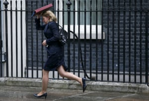 London, England: Education secretary Justine Greening runs in the rain after a cabinet meeting at 10 Downing Street