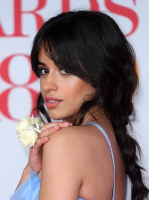 Camilla Cabello with her white rose on the red carpet.