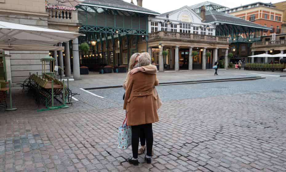 A rare embrace in London's Covent Garden, in a city obsessed with social distancing.