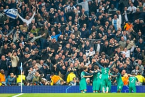 Tottenham players celebrate in front of their fans.