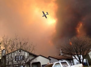 Canadian wildfires: a small plane flies above Fort McMurray