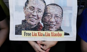 Protesters display a portrait of Liu Xiaobo and his detained wife Liu Xia.