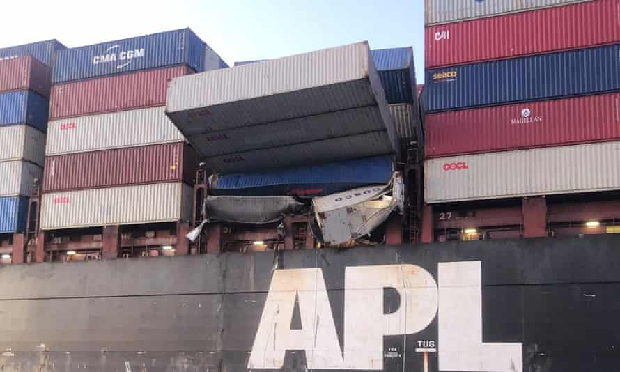 Shipping containers resting precariously on the APL England cargo ship.