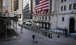 A person walks down Wall Street in New York. With a pandemic under way and a depression looming, the case for cancelling debt has taken on a new urgency.