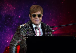 Elton John performing at the press conference for his Farewell Yellow Brick Road tour.