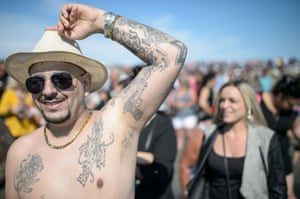 A man shows off his tattoos