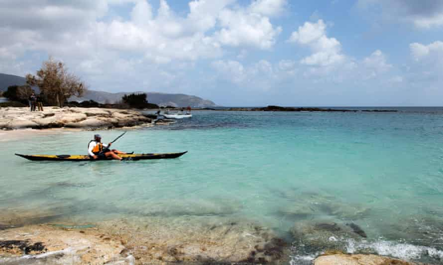A sea kayaker off Elafonisi, south-west Crete