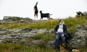 Four legs good: goats on Cléire Farm, run by Ed Harper (with guide dog Izzy).