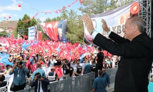 Turkish President Recep Tayyip Erdogan greeting the crowd during his meeting in Bayburt today